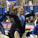 Photo of uf Gymnast with hands in air