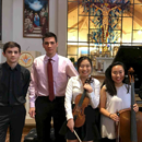 Photo of students holding violins