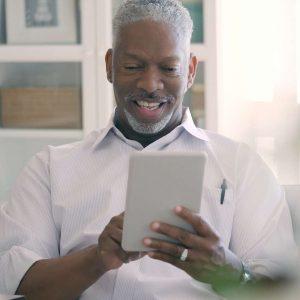 man holding an ipad